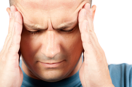 Man in need of headache treatment in DeLand