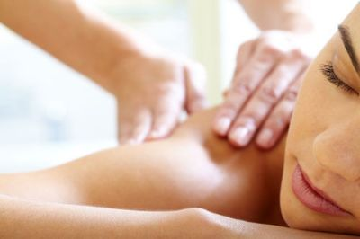 Woman receiving massage therapy in DeLand